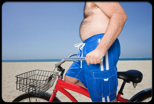 back_pain_myths_s6_man_with_bike_on_beach